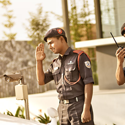 Two Senibong Cove security personnel at a security checkpoint